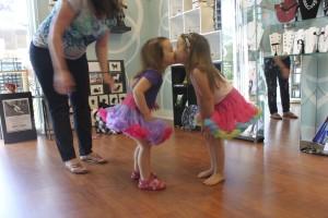 sisters sharing a kiss