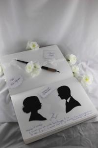 Guests sign their best wishes beside their silhouettes.