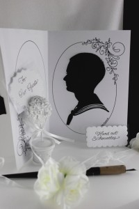 Two silhouettes are hand cut at once by folding. One goes home with the guest as a lovely souvenir to remember the occasion. The other one goes in the book.