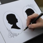 Guest signing the pictorial wedding guest book featuring guests' silhouettes and handwritten best wishes