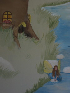 A fairy draws water near mouse houses at a tree base.