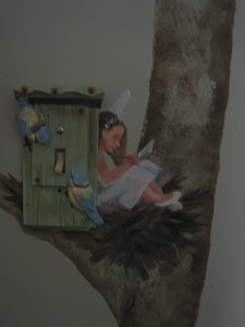 A fairy leans against a bird house reading a book.