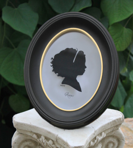 black oval silhouette cameo frame