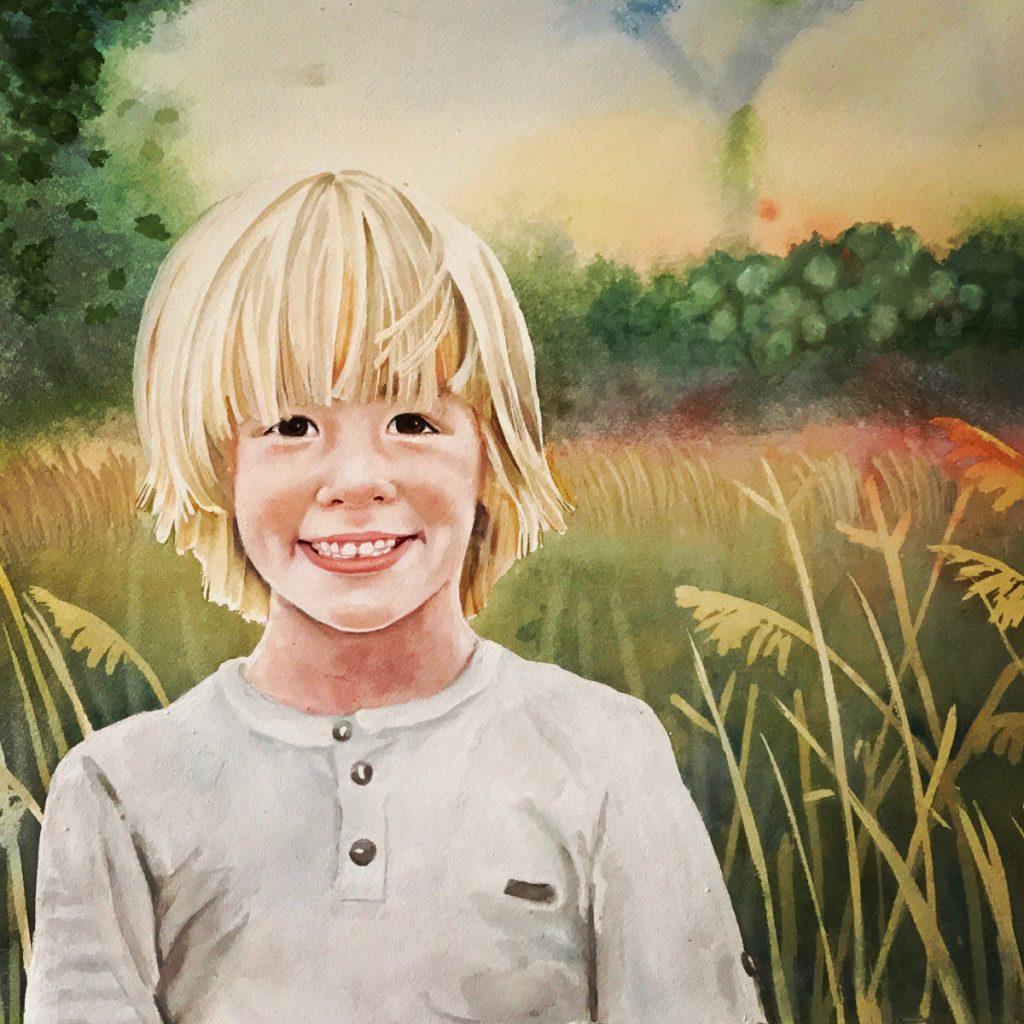 blond hair boy in meadow smiles